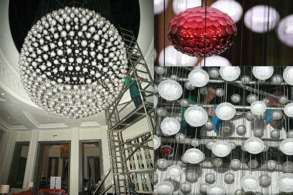 cleaning the murano moon chandelier at the Corinthia Hotel, London